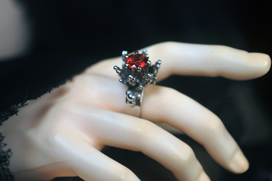 ... bright star garnet thorn ring - the horned moon, with one bright star